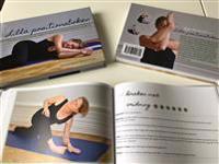 Lilla positionsboken : över åttio yinyogapositioner visade och beskrivna av Elisabeth Erlandsson Kaufmann